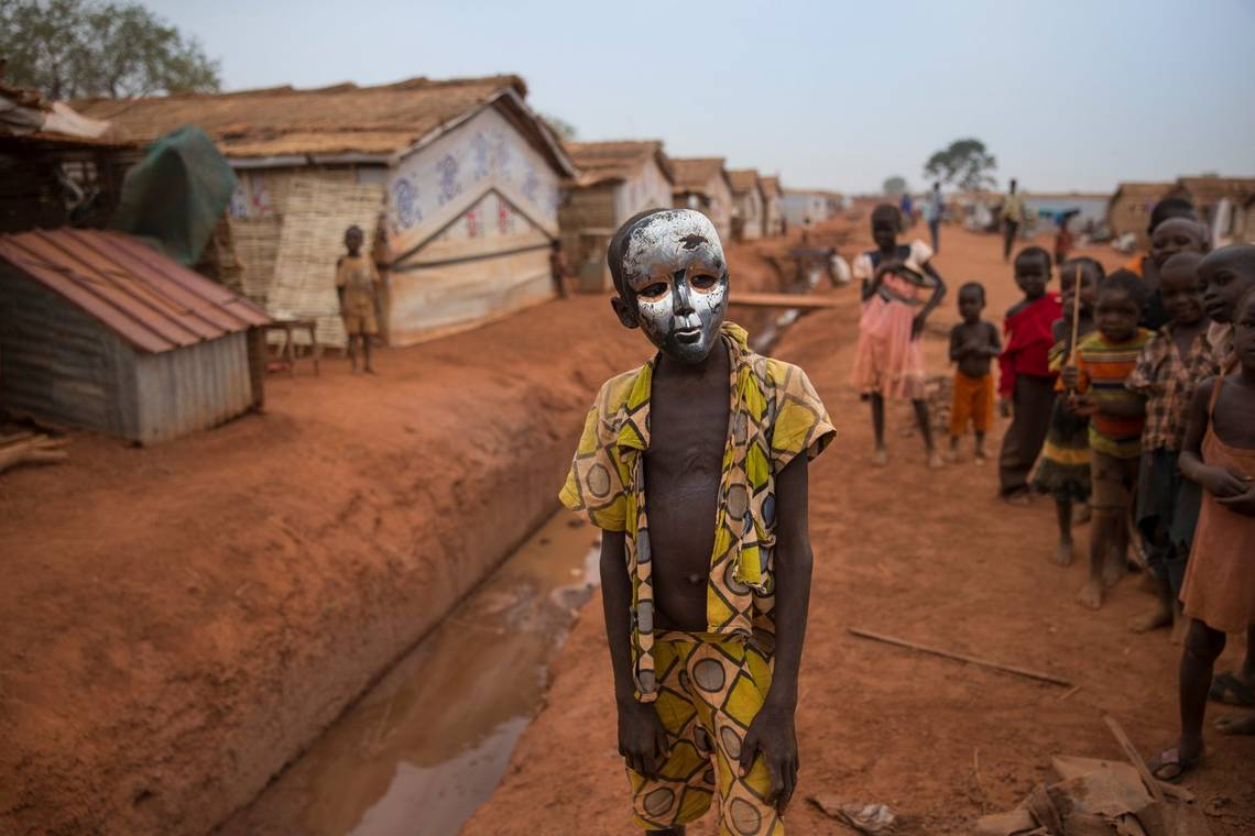 Canon Ambassador Ilvy Njiokiktjien's picture shows a young boy posing with a mask, taken on a Canon EOS-1D X.