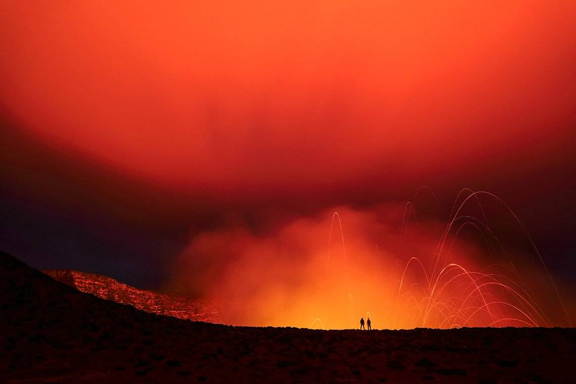 Two scientists by a volcano in Vanuatu, photographed by Ulla Lohmann on a Canon EOS 5D Mark IV.