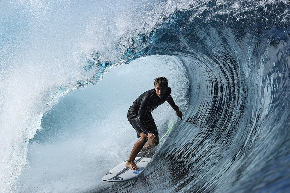 Surfer Kauli Vaast surfs inside the barrel of a wave. Taken by Ben Thouard on a Canon EOS-1D X Mark III.