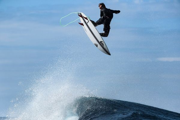 Kauli Vaast catches some air as he surfs in Tahiti. Photo by Ben Thouard taken on a Canon EOS-1D X Mark III.