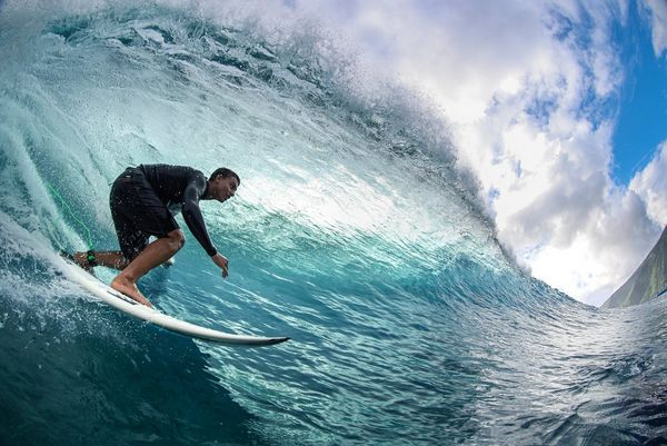 Surfer Kauli Vaast photographed with a fisheye lens as he rides a breaking wave.