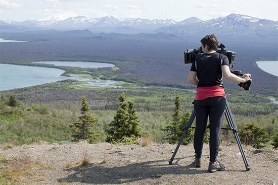Camerawoman Julie Monière filming in Katmai National Park, Alaska.