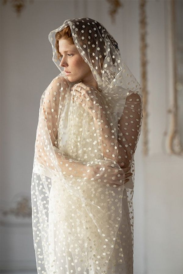 A bride wears a sheer white fabric. Photo by Félicia Sisco with a Canon RF 85mm F1.2L USM lens.