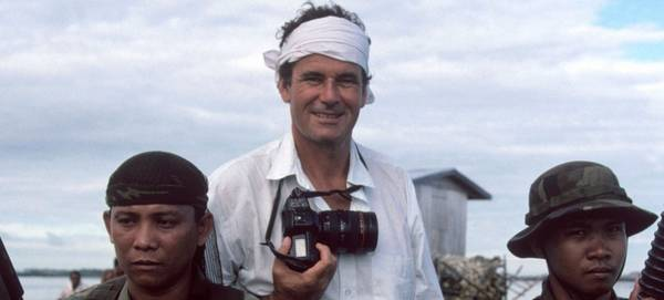 Magnum photographer Bruno Barbey with a Canon camera on an assignment.