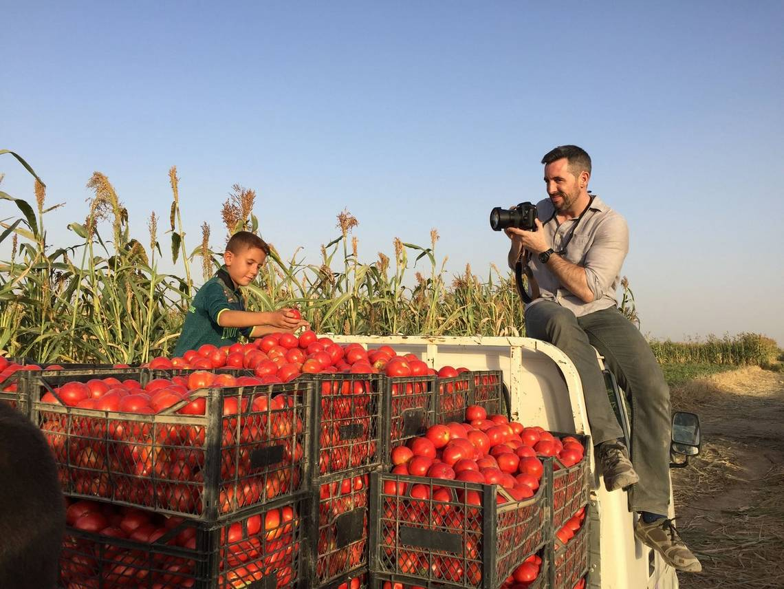 Canon Ambassador Ivor Prickett takes a photo of an Iraqi boy on a tomato truck.