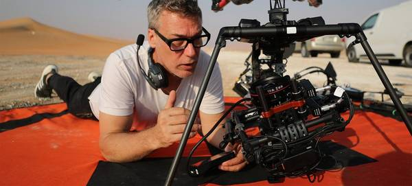 DOP Brett Danton adjusts a Canon EOS C200 mounted to a drone.