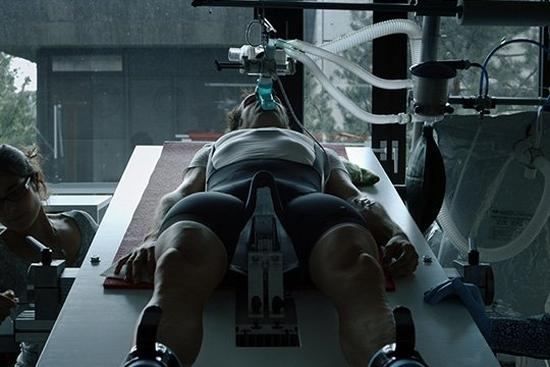Filmmaker Bryan Fogel lies on a laboratory bed attached to a respirator.