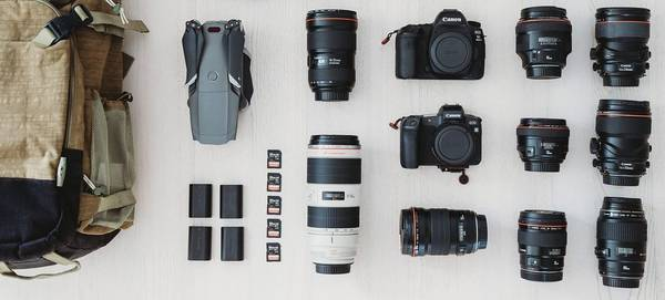 The contents of Markus Morawetz's wedding kitbag, including Canon EOS 5D Mark IV and EOS R bodies and a range of Canon lenses.