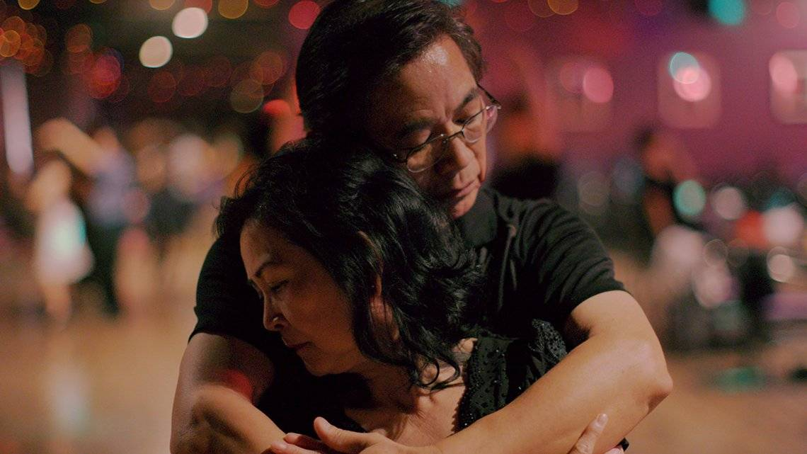 A couple embrace, in a still from Oscar-nominated documentary Walk Run Cha-Cha.