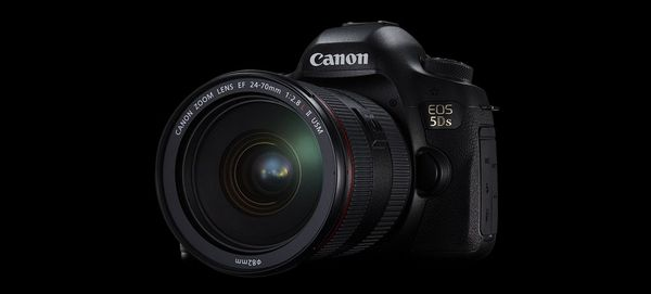 A Canon EOS 5DS camera sits against a black background.