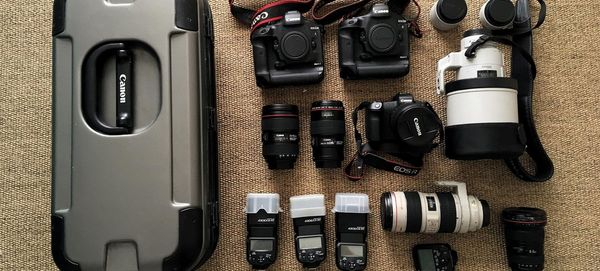 Christian Ziegler's kitbag, including two Canon EOS-1D X Mark II bodies and an EOS R.