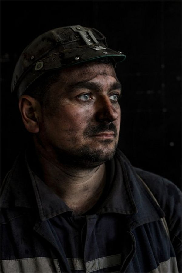 A portrait of a miner with coal dust covering his face – you can see it in every pore.
