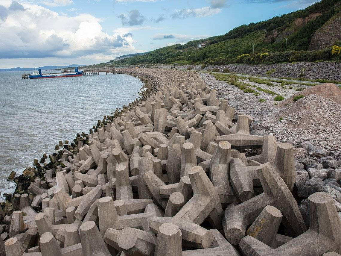What appears to be a rocky seashore is actually made up of interlocking concrete shapes, photographed by David Hurn on a Canon EOS 5DS R.