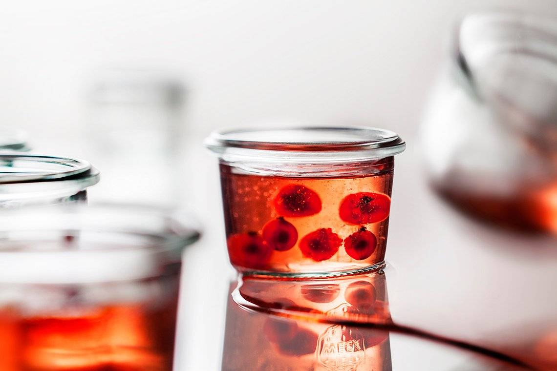 A jar of fruit conserve, with other jars out of focus. Photo by Eberhard Schuy with a Canon tilt-shift lens.