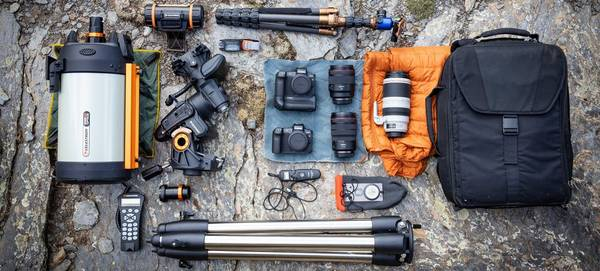 Fergus Kennedy's photography kit is laid out, including a Canon EOS Ra.