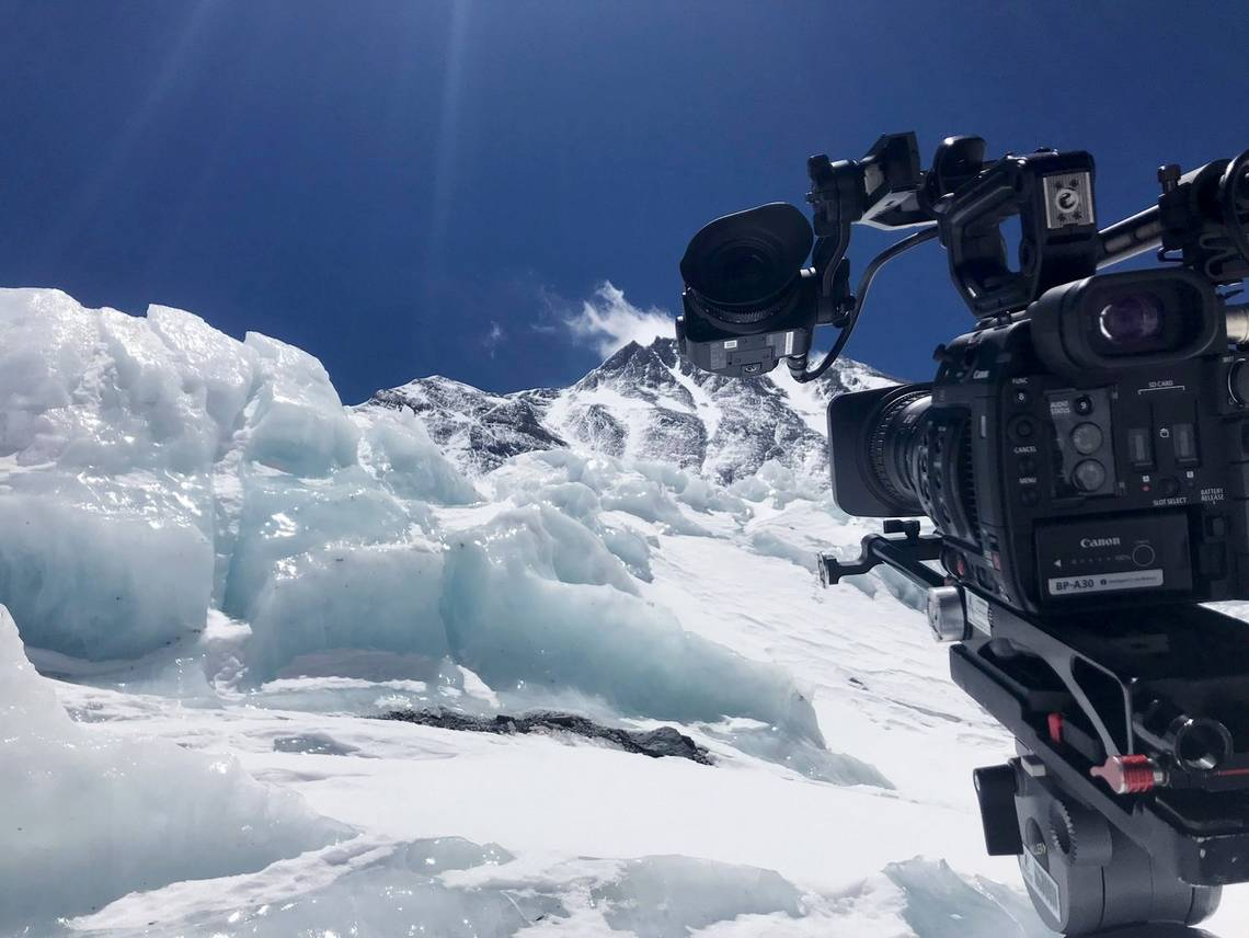A Canon EOS C200 camera in front of ice and snow at Mount Everest's South Base Camp in Nepal.