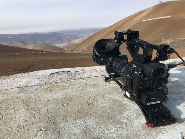 A Canon EOS C200 video camera on a rock.