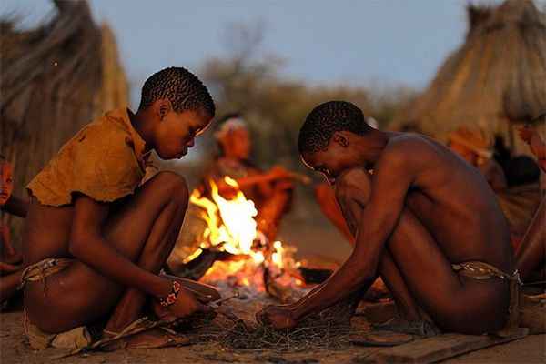 Two boys build a fire, photographed by Brent Stirton on a Canon EOS R.