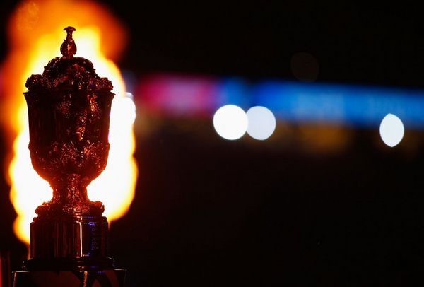 The Webb Ellis Cup is illuminated by flames during the opening ceremony before the England v Fiji match at Twickenham Stadium, Rugby World Cup 2015.