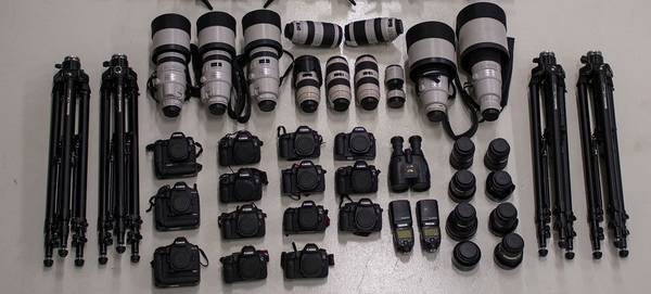 The contents of motorsports photographer Frits van Eldik's kitbag, including 14 Canon camera bodies and several telephoto lenses.