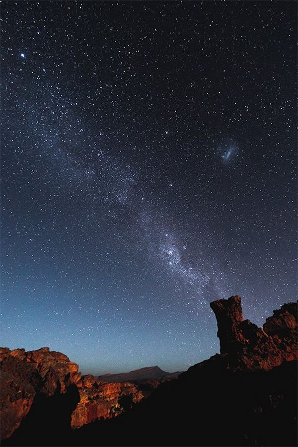 The Milky Way and stars above rock formations in South Africa.