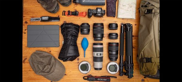 Gergo Kazsimer's photography kitbag with lenses, hiking kit and a Canon EOS RP.