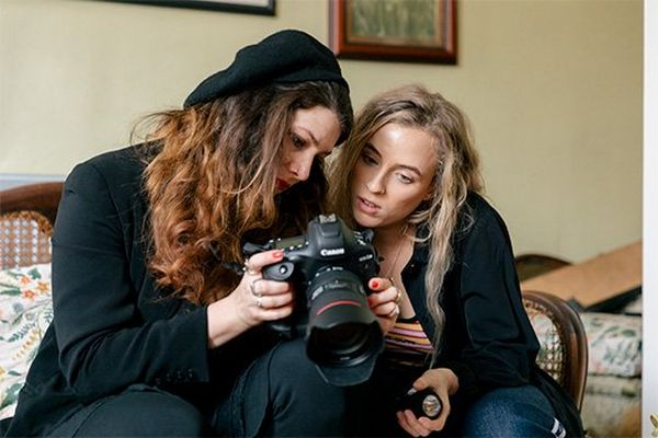 Fashion photographer Wanda Martin shows Rianna Gayle a picture on her Canon EOS-1D X Mark II's screen.
