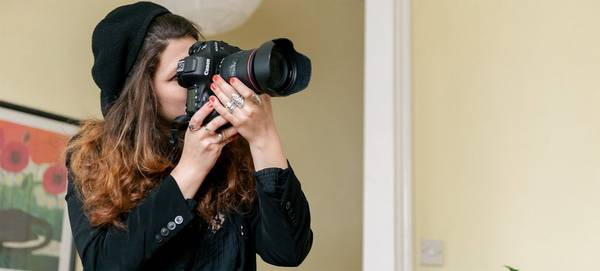 Photographer Wanda Martin takes a picture with a  Canon EOS-1D X Mark II.