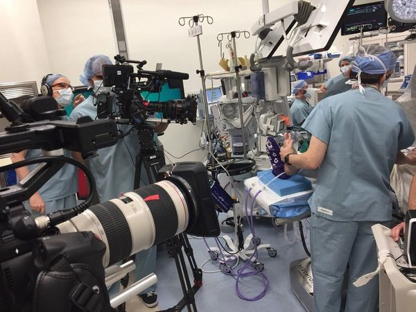 The crew of Hunting for Hedonia film in an operating theatre with Canon cameras and lenses.