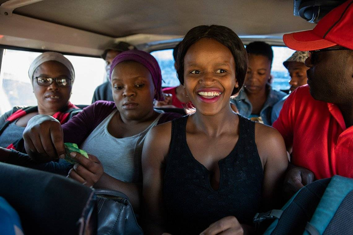 People in the back of a taxi in South Africa. Photo by Ilvy Njiokiktjien from her Born Free project.