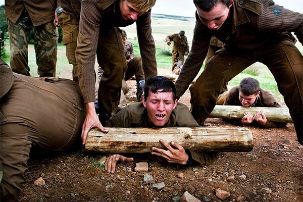 Teenage boys taking part in an assault course in South Africa.