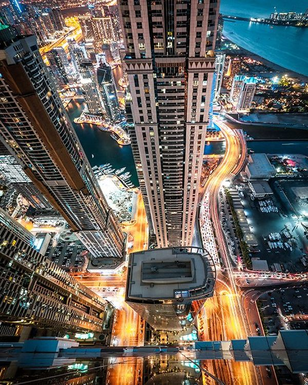 A view from one of the high rises in Dubai Marina, with a long exposure of the car lights far below reflected onto the glass in a mesmerising way.