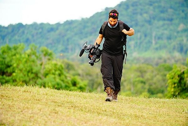 Peiman Zekavat walks outside carrying a Canon EOS C300 Mark II