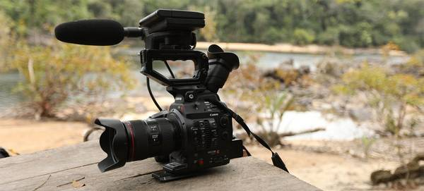 A Canon EOS C300 Mark II on a piece of wood beside the Essequibo River.