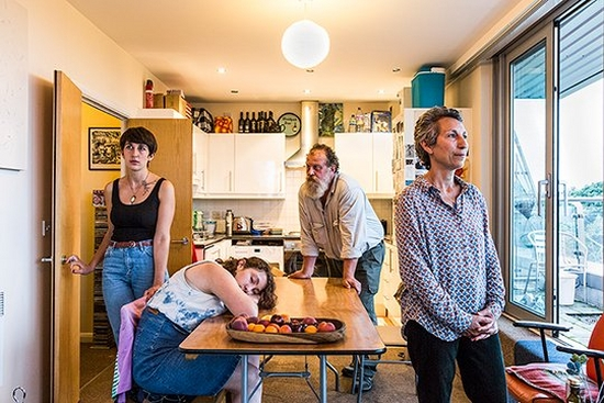 A family originally from South Africa in their London kitchen. Photo by Chris Steele-Perkins.