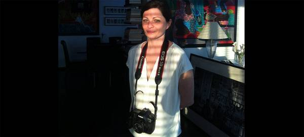 Magnum photographer Olivia Arthur with a Canon EOS 5D Mark II around her neck
