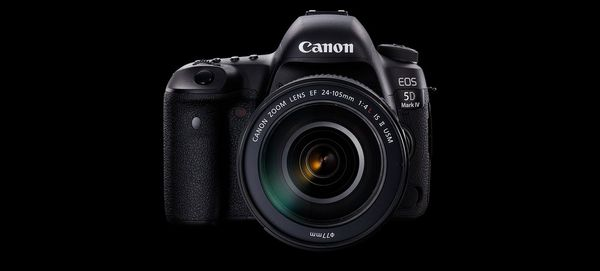 A Canon EOS 5D Mark IV sits against a black background