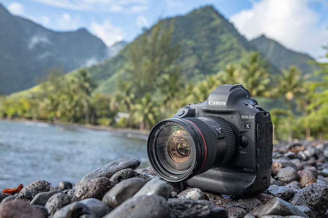 A Canon EOS-1D X Mark III on some rocks by the sea.