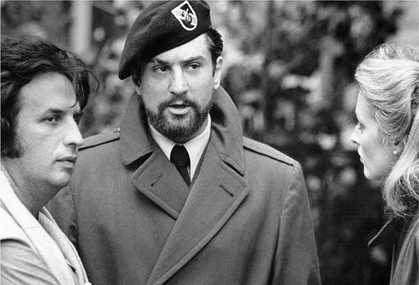 Michael Cimino and Robert De Niro in costume and on set for The Deer Hunter.