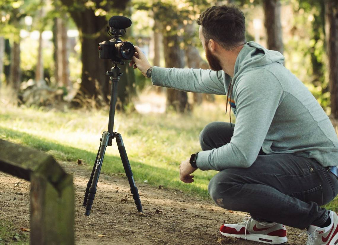 Stefan Michalak setting up to film a vlog in a park.