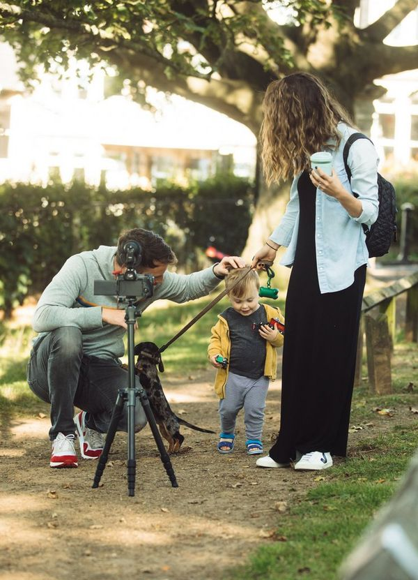 Stefan Michalak filming with his wife, son and dog in the park.