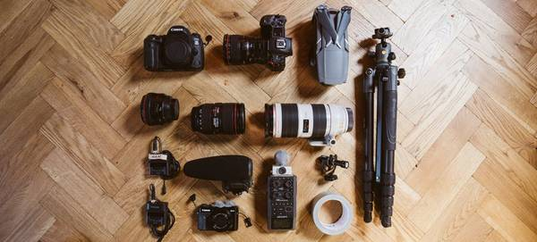Canon cameras and lenses including a Canon EOS 5D Mark IV, Canon EOS R, and Canon PowerShot G7 X Mark II.