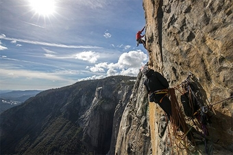 Two men scale the sheer cliff face of El Capitan in Yosemite National Park, where Oscar-winning documentary Free Solo was filmed using Canon equipment.