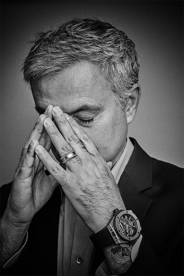 A black and white portrait of José Mourinho covering part of his face with his hands, in disappointment. Portrait by David Turecký on a Canon EOS 6D.