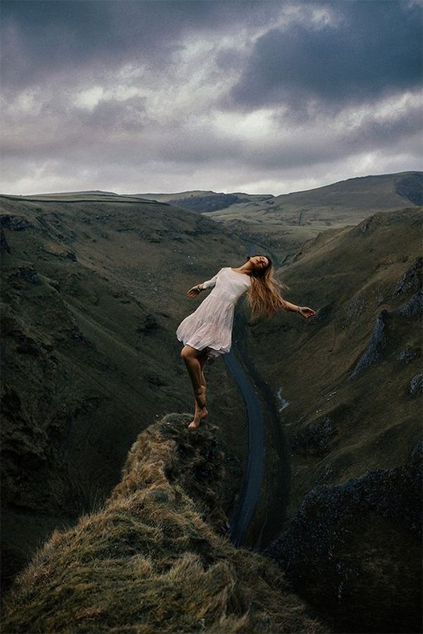Rosie Hardy appears to lean back on the edge of a cliff. Self-portrait by Rosie Hardy on a Canon EOS 5D Mark II.