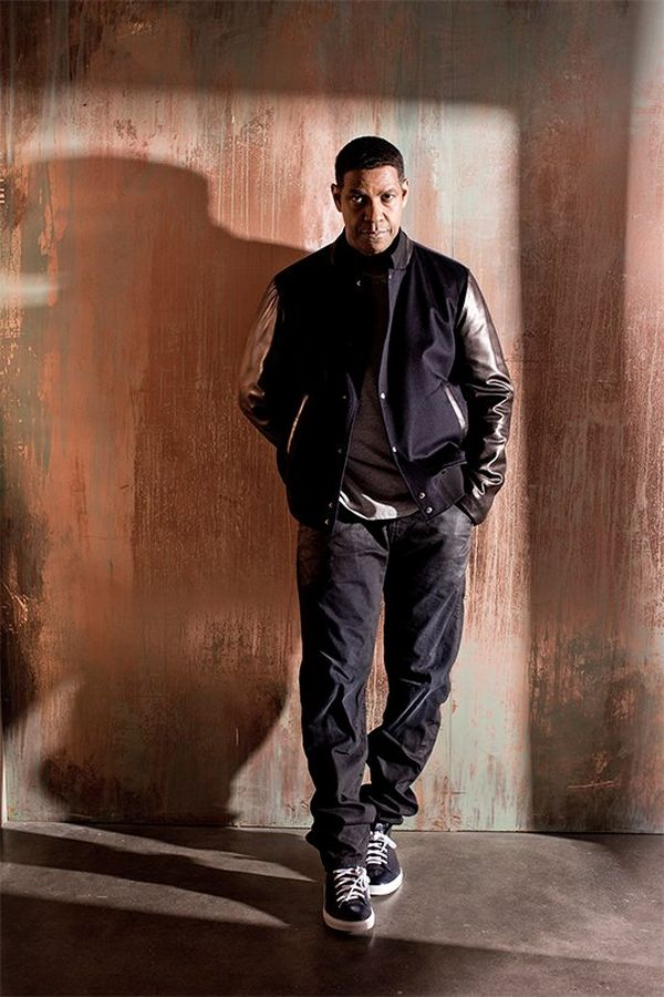 Denzel Washington stands against a distressed orange wall. Portrait by Lorenzo Agius on a Canon EOS 5D Mark III.