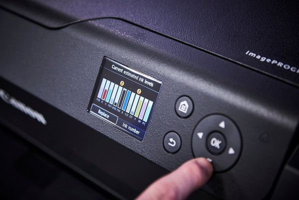 A close-up shot of the display on a Canon PROGRAF printer showing the ink levels.