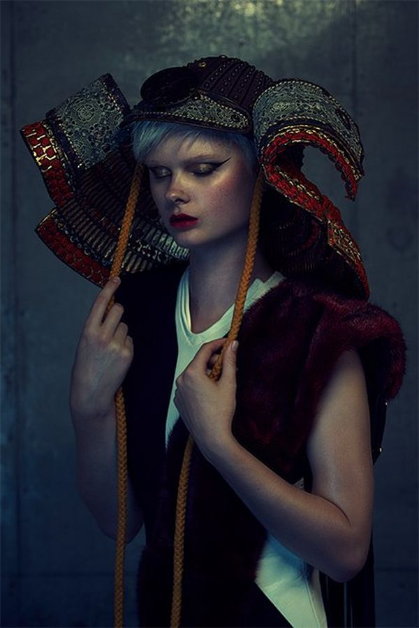 A blonde model wearing an elaborately embroidered Japanese Kabuto style headdress. Photographed by Quentin Caffier on a Canon EOS-1D X.