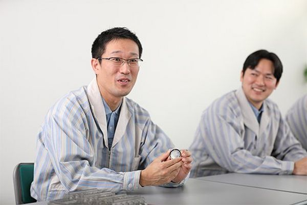 Two of the developers of the Canon RF 85mm F1.2L USM lens.