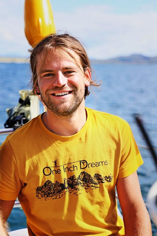 A portrait of a man, one of the daredevils from One Inch Dreams, taken on a boat – he smiles at the camera.